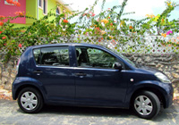 Grand Cayman Car Rentals with Cico Avis Rent A Car, Picture example of a Compact Daihatsu Sirion rental car