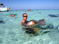 Holding a stingray in Grand Cayman